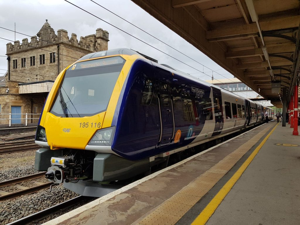Northern train number 195116, named 'Proud to be Northern', in  the platform at Lancaster bound for Manchester Airport